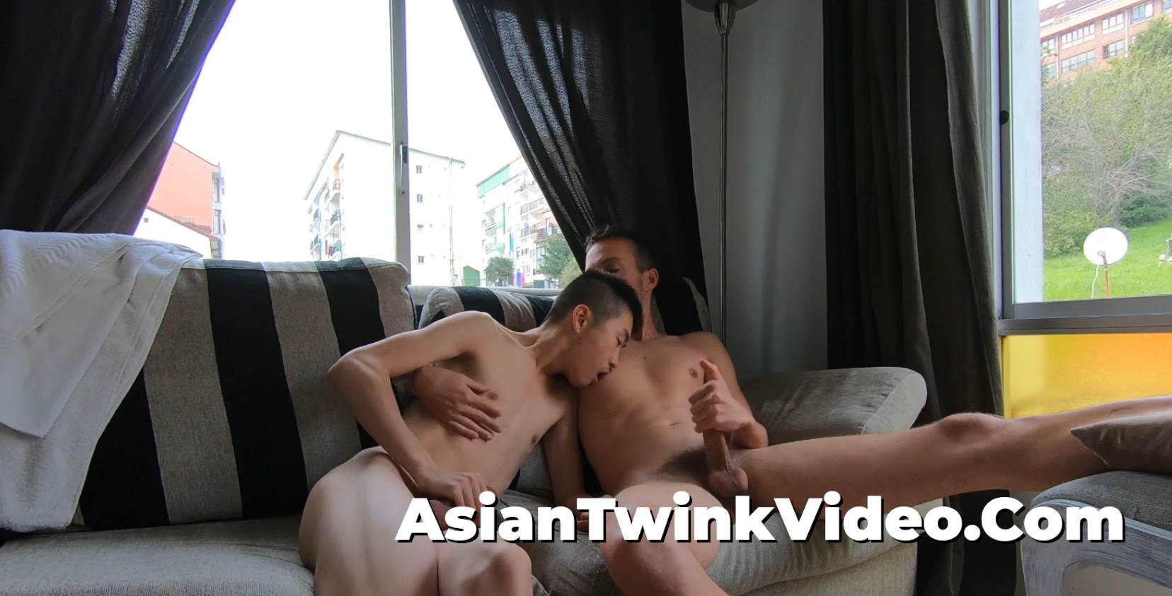 Asian-White Gay Couple Giving Each Other a Hand